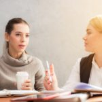 Two women discussing estate planning