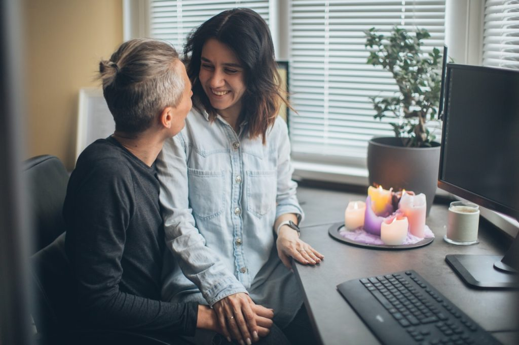 Young, married couple reviewing finances